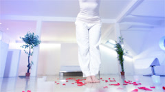 Young woman with nice lifestyle doing yoga in her contemporary home. High - stock footage