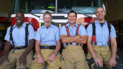 Portrait of firefighter group at station Stock Footage