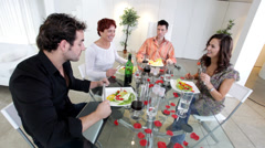 Stock Video Footage of Group of family or friends with nice lifestyle sit down for a dinner party in