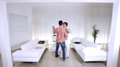 Couple in love, dancing together in their modern home. High quality HD video Stock Footage