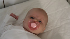 Baby girl and her dummy Stock Footage