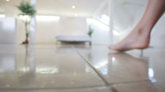 Petals cover the floor of this romantic scene with young woman in her Stock Footage