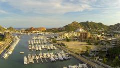 Cabo aerial flyover of downtown and Marina at Sunset Stock Footage
