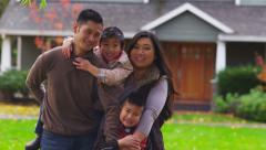 Asian family in front of home, portrait - stock footage