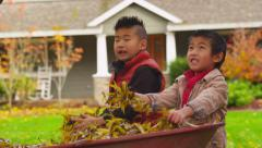 Family playing in fall, slow motion - stock footage