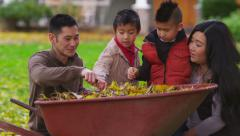 Family playing in fall, slow motion Stock Footage