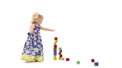 Cute young baby girl playing with building bricks in white studio Stock Footage