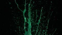 Slow motion shots of green paint splattering - stock footage