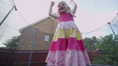 Pretty girl in summer on trampoline Stock Footage