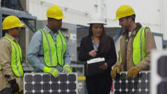 Industry workers plan solar panel installation - stock footage