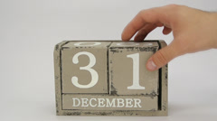 Putting appart a wooden calendar showing December, 31 - stock footage