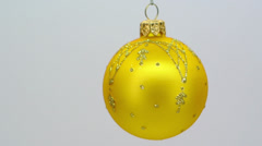 Yellow glass christmas ornament with gold pattern FullHD 1080p Stock Footage