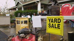 People shop at yard sale Stock Footage