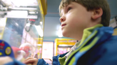 Children in a candy store exploring a variety of jars containing sweets and Stock Footage
