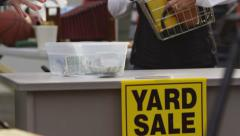 Making a garage sale purchase, closeup - stock footage
