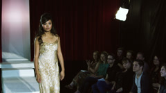 Spectators applauding models on catwalk runway at a fashion show Stock Footage