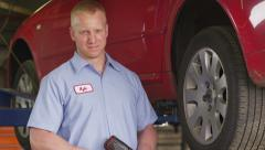 Portrait of auto mechanic - stock footage