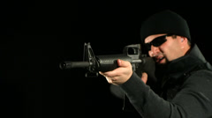 SWAT man shoots assault rifle, slow motion Stock Footage