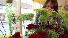 Florists small business retail shop.  Customer browsing a selection of flowers. Stock Footage