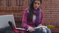 Stock Video Footage of College student studying outdoors with laptop computer