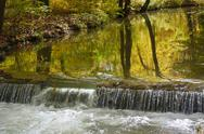 Stock Photo of autumn brook with waterfall