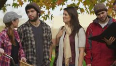 Group of college students hanging out on campus - stock footage