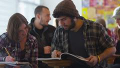 College students sitting in classroom studying - stock footage