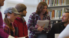 Group of college students meeting in library - stock footage