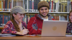 Group of college students in library - stock footage