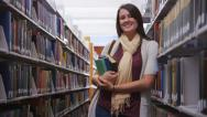 Stock Video Footage of College student in library holding books