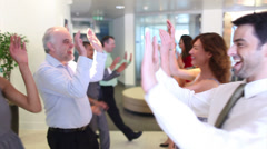Confident winning business team clap hands together and high five. High quality Stock Footage