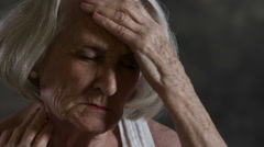 Elderly woman with headache Stock Footage