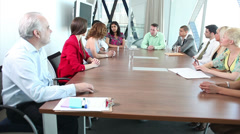 Large boardroom AGM meeting with mixture of creative looking business people Stock Footage