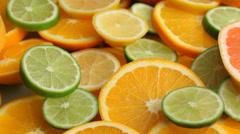 Fresh citrus fruit slices - stock footage