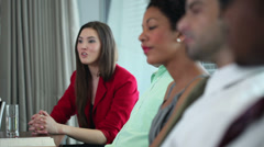 Large boardroom AGM meeting with mixture of creative looking business people.  Stock Footage