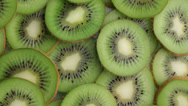 Stock Video Footage of Kiwi fruit slices, closeup