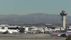 Aircraft taxi, take off and land at LAX airport Stock Footage