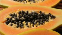 Fresh sliced papaya, fruit background Stock Footage