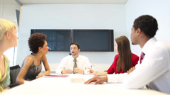 Business people in relaxed discussion area in office. High quality HD video - stock footage