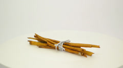 Bunch of cinnamon sticks tied with a grey ribbon FullHD 1080p Stock Footage
