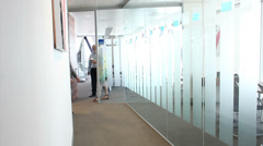 Business people walking in corridoor of large business offices. High quality HD - stock footage