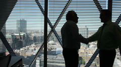 Businessman looking over city view from executive office. High quality HD video Stock Footage