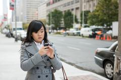 Woman on busy street Stock Photos