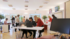 Busy office staff film with time lapse effect causing blurring and motion Stock Footage
