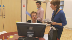 Hard working business team in a busy modern office. High quality HD video Stock Footage