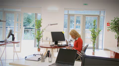 Young businesswoman in an office struggling with a heavy workload. Stock Footage