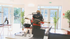 Young businesswoman in an office struggling with a heavy workload. High quality Stock Footage