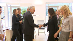 Two business teams meet and shake hands. High quality HD video footage Stock Footage