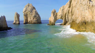 Stock Video Footage of Cabo Arch aerial approach to famous front side at lands end