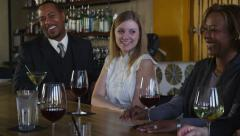 Group of people at restaurant talking and laughing Stock Footage